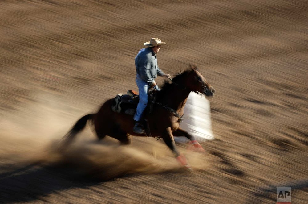 In this Sept. 23, 2017, photo, Wade Earp competes in the barrel racing event at the Bighorn Rodeo in Las Vegas. (AP Photo/John Locher)