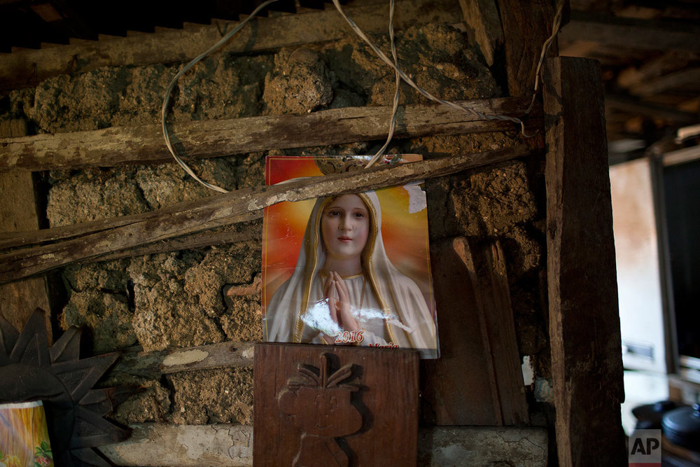 In this Sept. 26, 2017 photo, an image of Virgin Maria decorates a person's shack home in the Lins slum of Rio de Janeiro, Brazil. The World Bank estimates that between the start of 2016 and the end of this year, 2.5 million to 3.6 million Brazilians will have fallen below the poverty line of 140 Brazilian reais per month, about $44 at current exchange rates. (AP Photo/Silvia Izquierdo)