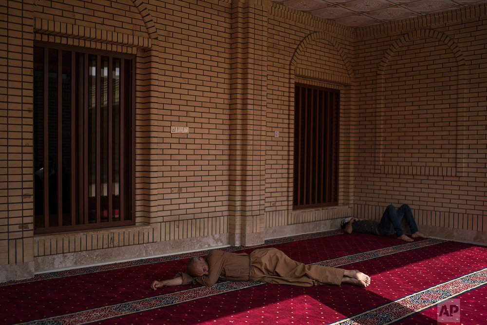 Kurdish men rest outside a mosque in central Irbil, Iraq, Wednesday, Oct. 25, 2017. In Sept. 2017, Iraq's Kurds celebrated their symbolic vote for independence, but instead of moving forward with negotiations toward a smooth divorce from Baghdad, they have lost their most important oil-producing city to Iraqi troops, squeezing a hurting economy and dashing the hopes of an independent state. (AP Photo/Felipe Dana)