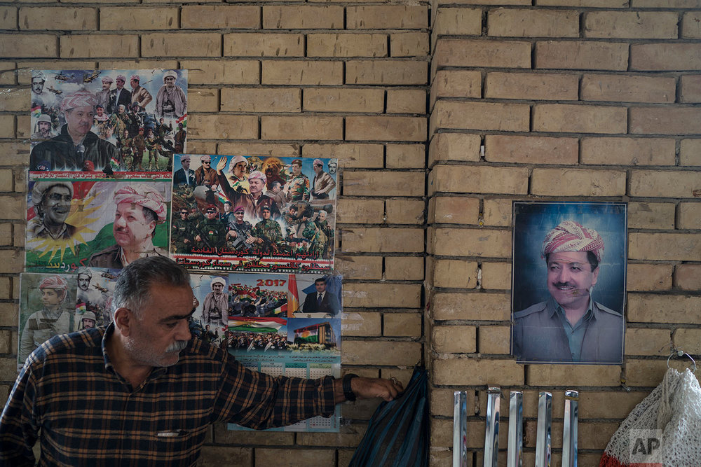 Photos of Kurdish president Masoud Barzani hang on the walls of the central bazaar in Irbil, Iraq, Wednesday, Oct. 25, 2017. In Sept. 2017, Iraq's Kurds celebrated their symbolic vote for independence, but instead of moving forward with negotiations toward a smooth divorce from Baghdad, they have lost their most important oil-producing city to Iraqi troops, squeezing a hurting economy and dashing the hopes of an independent state. (AP Photo/Felipe Dana)