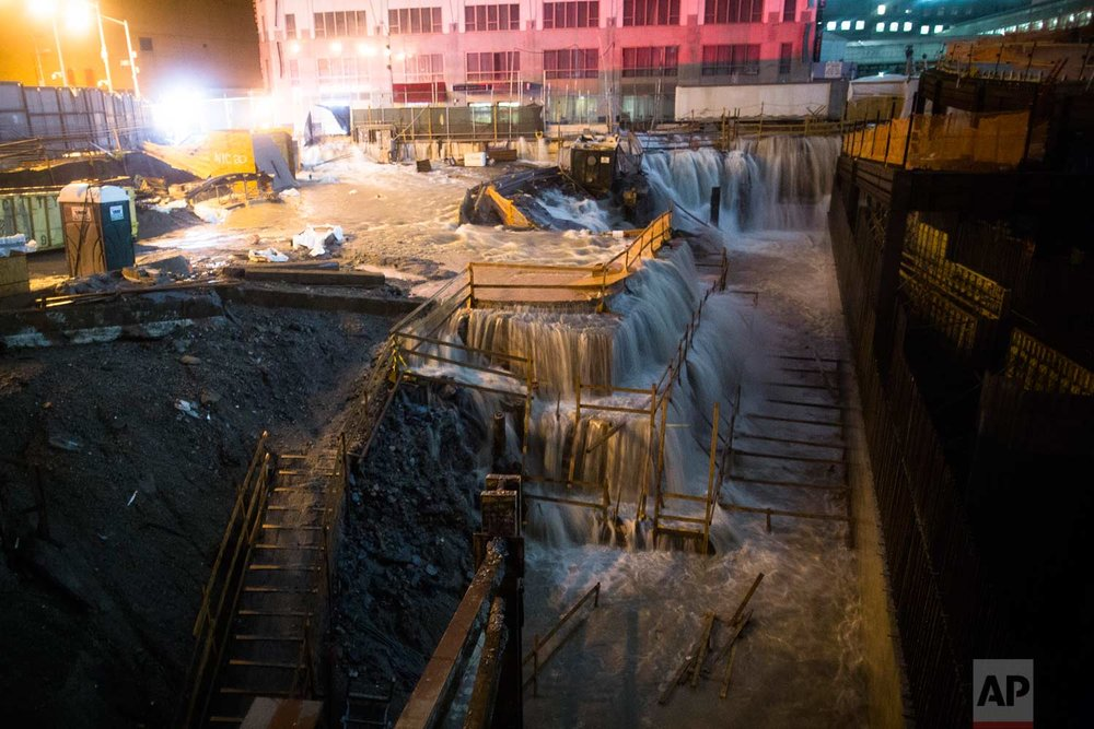 Sea water floods the Ground Zero construction site, Monday, Oct. 29, 2012, in New York. Sandy continued on its path Monday, as the storm forced the shutdown of mass transit, schools and financial markets, sending coastal residents fleeing, and threatening a dangerous mix of high winds and soaking rain.  (AP Photo/John Minchillo)
