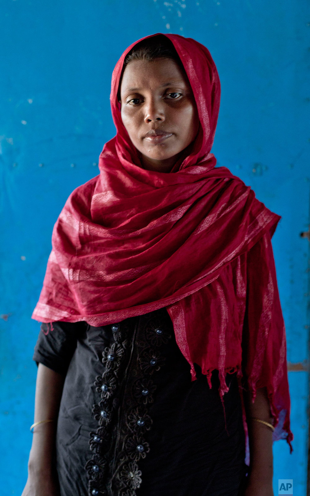 """In this Oct. 1, 2017, photo, Rohingya Muslim woman Malika, from Myanmar's Moidaung village, stands for a photograph at Kutupalong camp for newly arrived Rohingya refugees in Bangladesh. Three of Malika's children, aged six-months to six-years, drowned when the fishing boat they were traveling in, to make their escape from Myanmar, capsized on  Sept. 28. """"That's when I knew something had gone terribly wrong. I knew we had gone too far when people started throwing up,"""" Malika said on smelling saltwater and realizing they were in the ocean when the boat lost its way. (AP Photo/Gemunu Amarasinghe)"""
