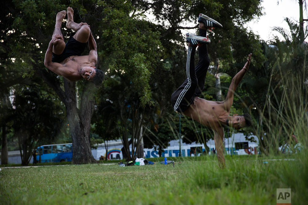 Alfredo Lopez, 22, left, and Cesar Munoz, practice parkour at Paseo Los Proceres in Caracas, Venezuela, Sunday, Oct. 22, 2017. (AP Photo/Rodrigo Abd)