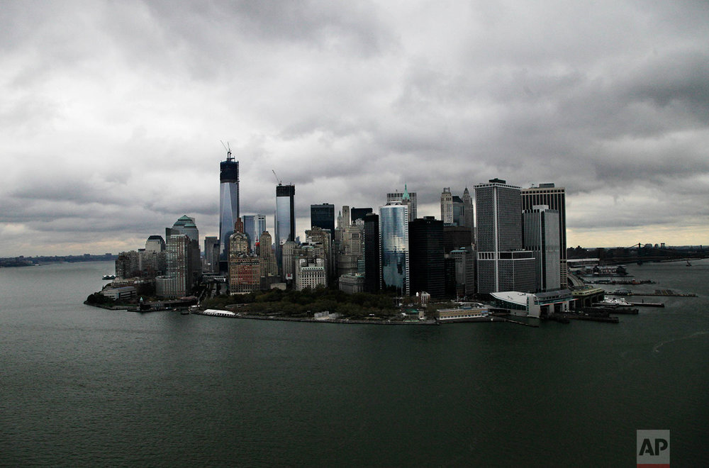 This aerial photo of Wednesday, Oct. 31, 2012, shows the New York skyline and harbor. The vast destruction wreaked by the storm surge in New York could have been prevented with a sea barrier of the type that protects major cities in Europe, some scientists and engineers say. The multibillion-dollar price tag of such a project has been a hindrance, but may appear more palatable after the damage from Superstorm Sandy has been tallied. (AP Photo/Mark Lennihan)