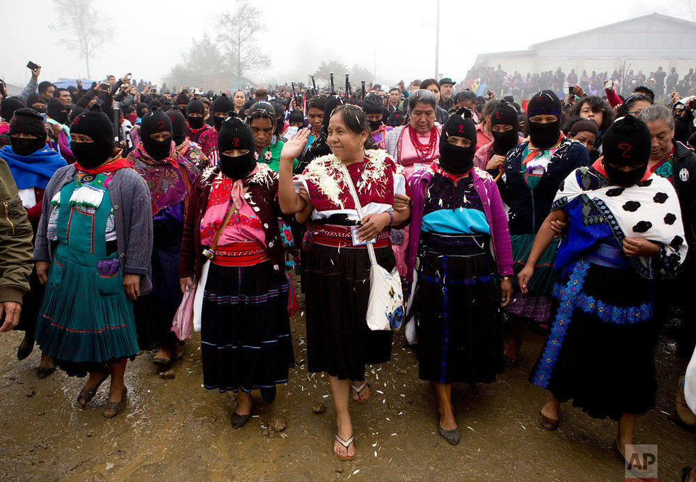In this Thursday, Oct. 19, 2017 photo, Maria de Jesus Patricio, presidential candidate for the National Indigenous Congress, campaigns with an escort of masked indigenous women in the Zapatista stronghold of Oventic in the southern state of Chiapas, Mexico. Even though Patricio's backers say their candidate is handicapped by electoral officials using a smartphone app to record the signatures necessary to get candidates on the ballot, she came in second place after the wife of former president Felipe Calderon. (AP Photo/Eduardo Verdugo)