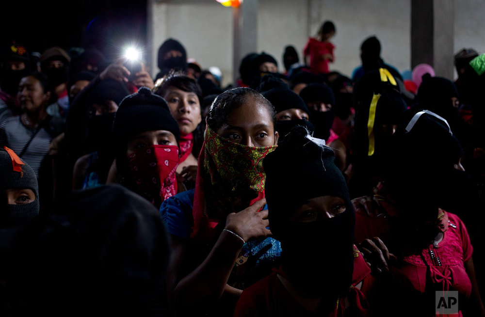 In this Tuesday, Oct. 17, 2017 photo, Zapatistas listen to Maria de Jesus Patricio, presidential candidate for the National Indigenous Congress, during a campaign event in the Zapatista stronghold of Roberto Barrios in the southern state of Chiapas, Mexico. Some critics argue that the system of independent candidates, in place for the first time in this presidential race, will wind up helping the ruling party by fragmenting the opposition vote. (AP Photo/Eduardo Verdugo)