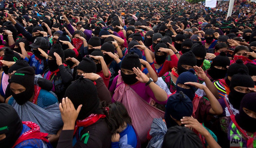 "In this Monday, Oct. 16, 2017 photo, Zapatistas salute during the playing of Mexico's national anthem at a campaign rally for Maria de Jesus Patricio, presidential candidate for the National Indigenous Congress, in the Zapatista stronghold of La Garrucha in the southern state of Chiapas, Mexico. ""We are not looking for power,"" said Chiapas activist Lucia Guzman Gomez, who participated in Patricio's campaign tour through Chiapas. ""We are looking for a space to participate as human beings, as indigenous people."" (AP Photo/Eduardo Verdugo)"