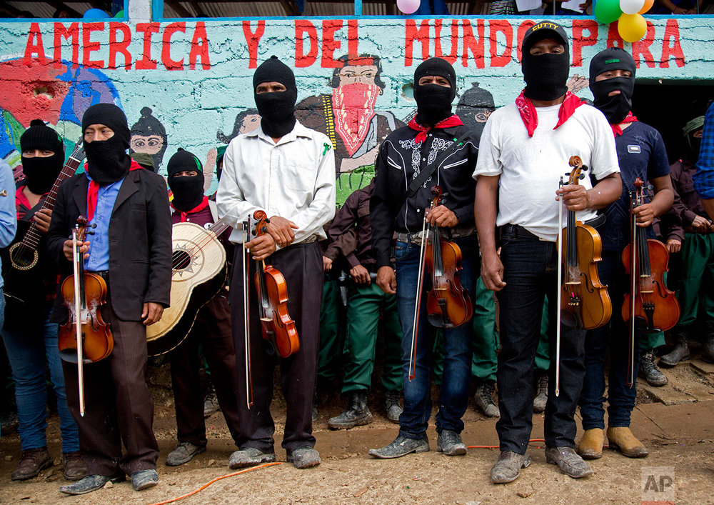 In this Monday, Oct. 16, 2017 photo, musicians stand by during a campaign rally for Maria de Jesus Patricio, presidential candidate for the National Indigenous Congress, in the Zapatista stronghold of La Garrucha in the southern state of Chiapas, Mexico. The Zapatistas staged a brief armed uprising in 1994 for greater indigenous rights. (AP Photo/Eduardo Verdugo)