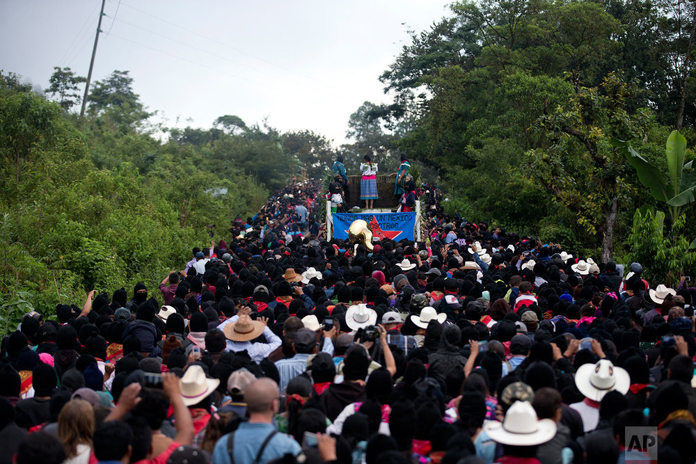 "In this Sunday, Oct. 15, 2017 photo, Maria de Jesus Patricio, presidential candidate for the National Indigenous Congress, campaigns on the back of a moving truck in the Zapatista stronghold of Morelia in the southern state of Chiapas, Mexico. ""We have to unite our pain and our rage,"" said Patricio, a traditional healer from the western state of Jalisco. ""We have to unite with the people of civic groups who live in the cities, they are suffering too."" (AP Photo/Eduardo Verdugo)"