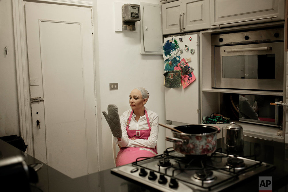 Egyptian satirist Sherine Arafa dressed up for halloween as 'Sophia the Robot,' who has recently been declared a citizen of the Kingdom of Saudi Arabia, poses for a photograph in her kitchen at her home, in Cairo, Egypt, Tuesday, Oct. 31, 2017. (AP Photo/Nariman El-Mofty)