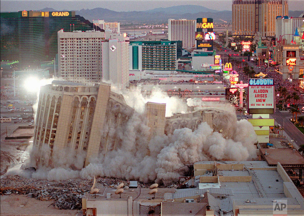 In this April 27, 1998, photo, taken by Associated Press photographer Lennox McLendon, shows the Aladdin Hotel & Casino comes tumbling down as it is imploded in Las Vegas. The Aladdin, built in 1966, was imploded to make way for the $1.3 billion Aladdin Project, which will be completed in the spring of 2000. (AP Photo/Lennox McLendon)