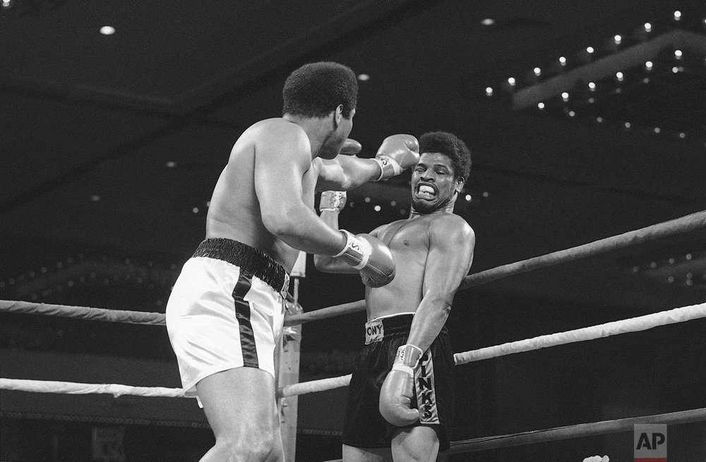 "Leon Spinks, right, bobs back on Wednesday, Feb. 15, 1978 evading left jab by champion Muhammad Ali early in title fight in Las Vegas, Nevada. ""I underestimated him, he is a tough kid"", Ali said in his dressing room, after officials awarded the fight, and the title to Spinks. (AP Photo/Lennox McLendon)"