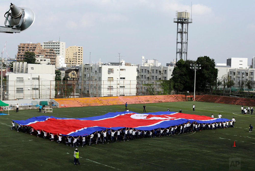 In this Sept. 26, 2017, photo, students practice forming the North Korean flag during a performance at a Korean high school in Tokyo. (AP Photo/Eugene Hoshiko)