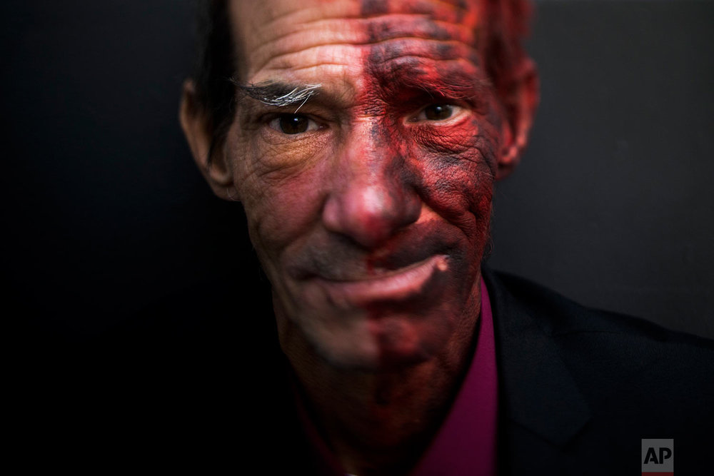 "James Harris, 54, pauses for photos Tuesday, Oct. 3, 2017, in Los Angeles. ""I'm currently dressed up as Two-Face. I'm tired of panhandling. I'm not making money as a panhandler when I need food and supplies,"" said Harris who has been homeless over a year. (AP Photo/Jae C. Hong)"
