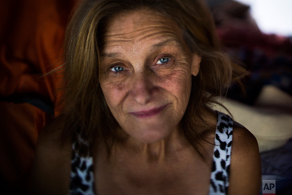 "Tammy Stephen, 54, pauses for photos Tuesday, Sept. 26, 2017, in Seattle. Stephen lives in Camp Second Chance, a city-sanctioned homeless encampment in Seattle. ""Housing here is out of control. That's why we have so many people on the street,"" she said. ""There's nowhere for them to go."" (AP Photo/Jae C. Hong)"