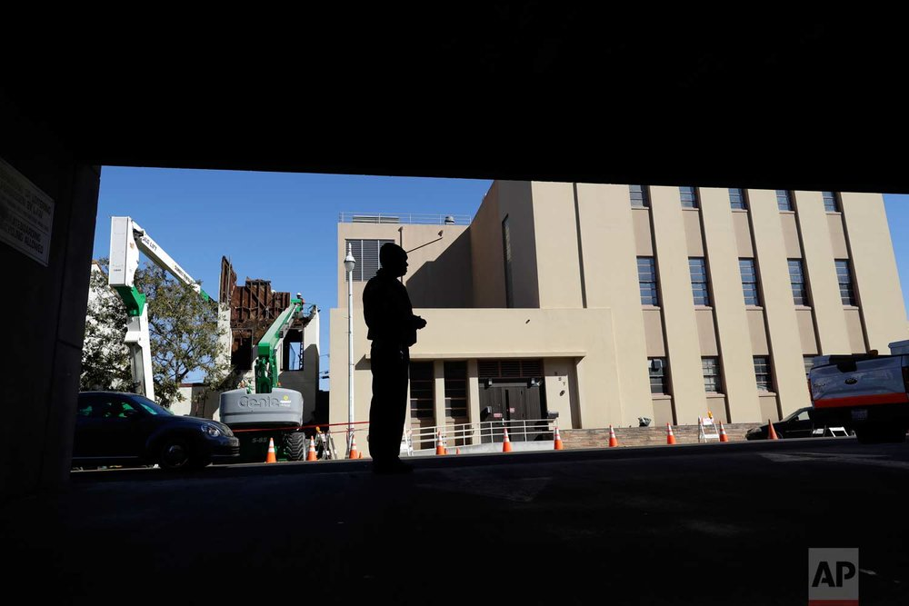 In this photo taken Oct. 26, 2017, Albert Brown III, who works as a security officer, looks out onto the street at a street corner near his work in San Carlos, Calif. (AP Photo/Marcio Jose Sanchez)