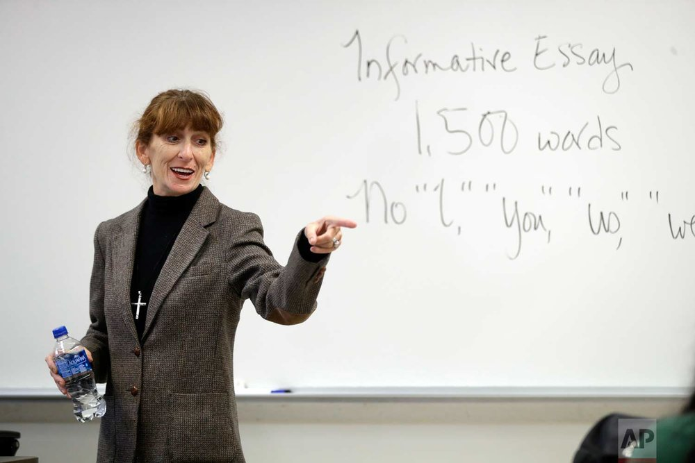 In this photo taken Oct. 11, 2017, Ellen Tara James-Penney, a lecturer at San Jose State University, speaks to her English class on the university's campus in San Jose, Calif. (AP Photo/Marcio Jose Sanchez)