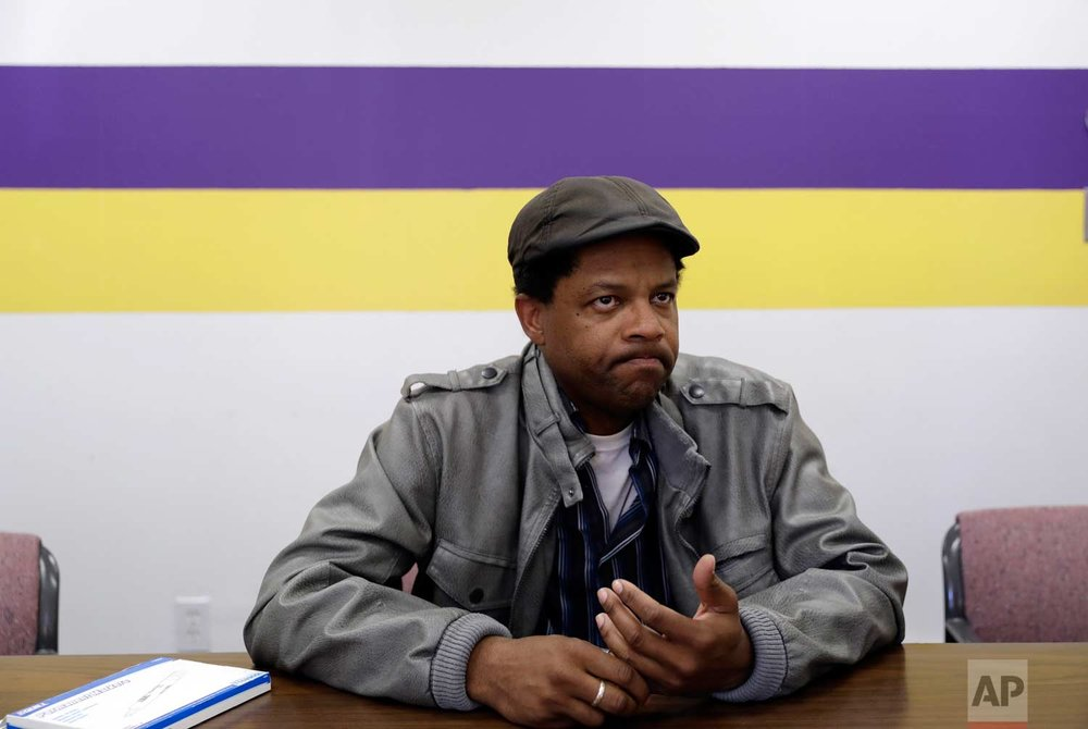 In this photo taken Oct. 25, 2017, Albert Brown III, who works as a security officer, talks about living in homelessness in San Jose, Calif. Brown recently signed a lease for half of a $3,400 two-bedroom unit in Half Moon Bay, about 13 miles from his job. (AP Photo/Marcio Jose Sanchez)