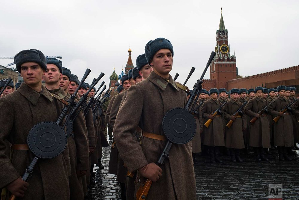Russian soldiers dressed in Red Army World War II uniforms prepare to march during a rehearsal of a historical parade in Red Square, in Moscow, Russia, Sunday, Nov. 5, 2017. (AP Photo/Alexander Zemlianichenko)