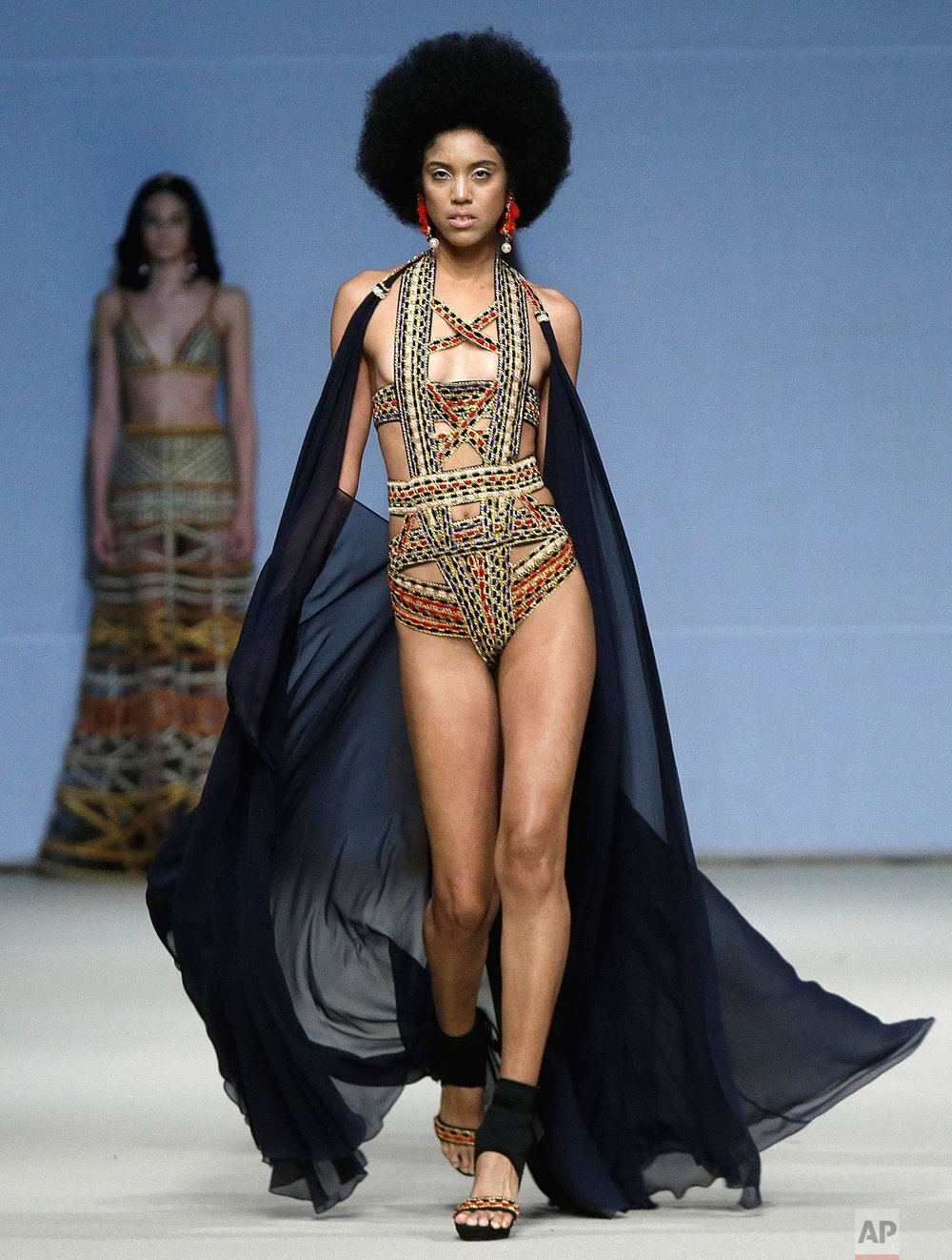 A model wears a creation from the Ani Alvarez Calderon spring/summer collection during Fashion Week in Lima, Peru, Thursday, Oct. 26, 2017. (AP Photo/Martin Mejia)