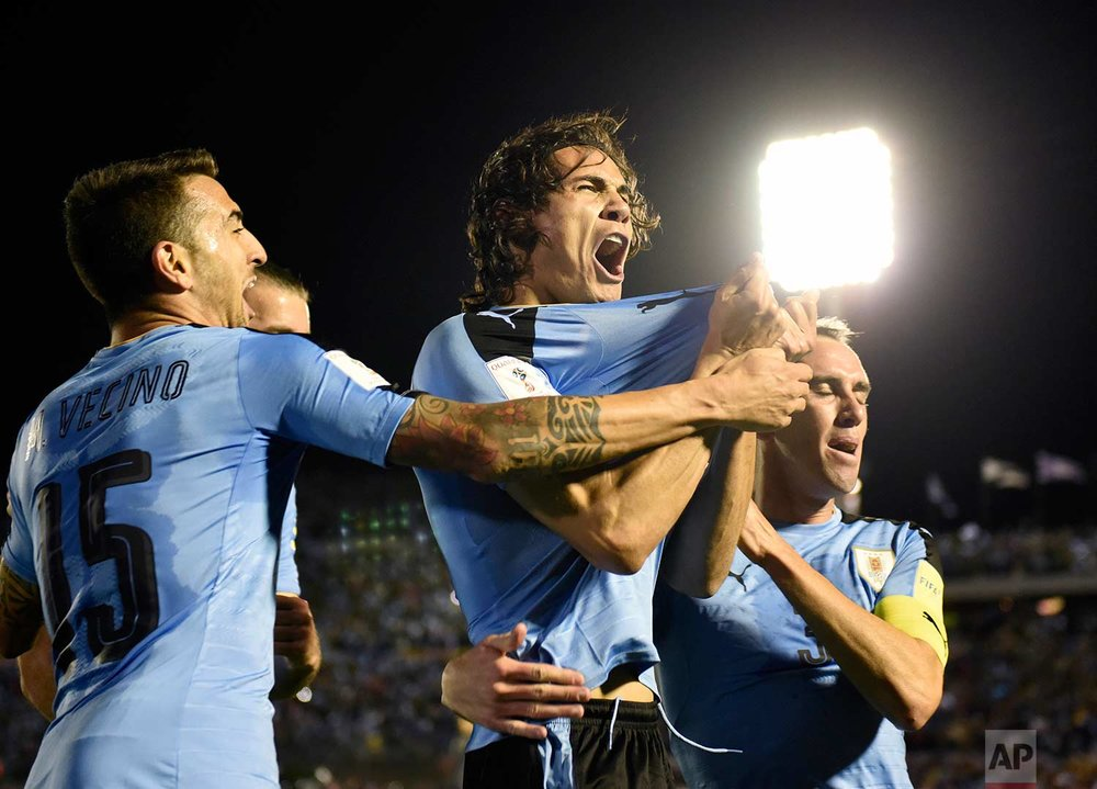 Uruguay's Edinson Cavani, center, celebrates after scoring against Bolivia during a 2018 World Cup qualifying soccer match in Montevideo, Uruguay, Tuesday, Oct. 10, 2017. (AP Photo/Matilde Campodonico)
