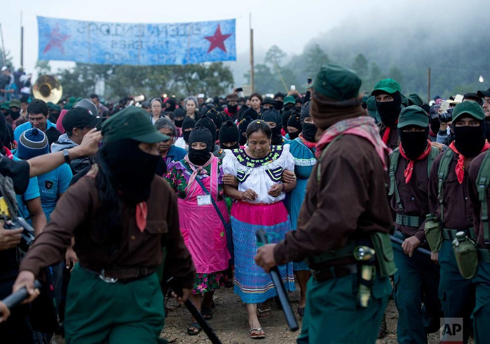 In this Sunday, Oct. 15, 2017 photo, presidential candidate for the National Indigenous Congress, Maria de Jesus Patricio, is escorted by Zapatistas at her campaign rally in the Zapatista stronghold of Morelia, in the southern state of Chiapas, Mexico. (AP Photo/Eduardo Verdugo)