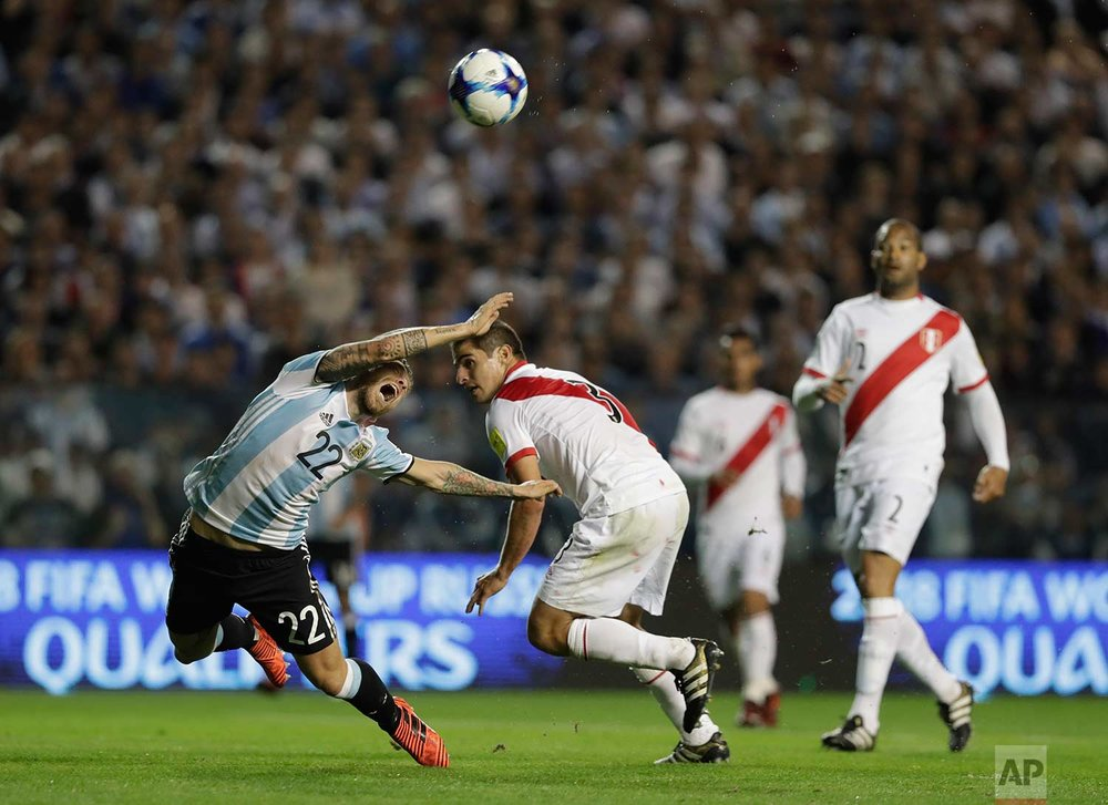 Argentina's Alejandro Gomez, left, is fouled by Peru's Aldo Corzo during a World Cup qualifying soccer match at La Bombonera stadium in Buenos Aires, Argentina, Thursday, Oct. 5, 2017. (AP Photo/Natacha Pisarenko)
