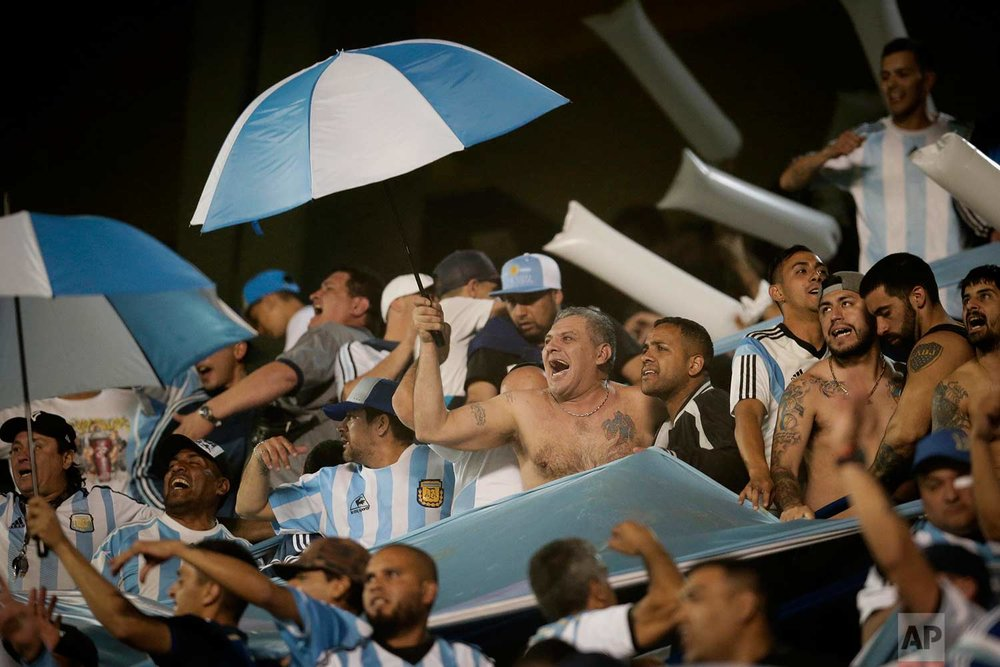 Fans cheers for Argentina during a World Cup qualifying soccer match against Peru at La Bombonera stadium in Buenos Aires, Argentina, Thursday, Oct. 5, 2017. (AP Photo/Victor R. Caivano)