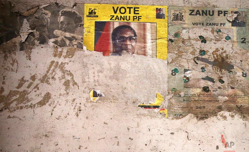 Part of an election poster from the 2008 Zanu Pf election campaign is seen the wall of a dilapidated building in the Mbara suburb of Harare, Friday Nov. 17, 2017. (AP Photo)