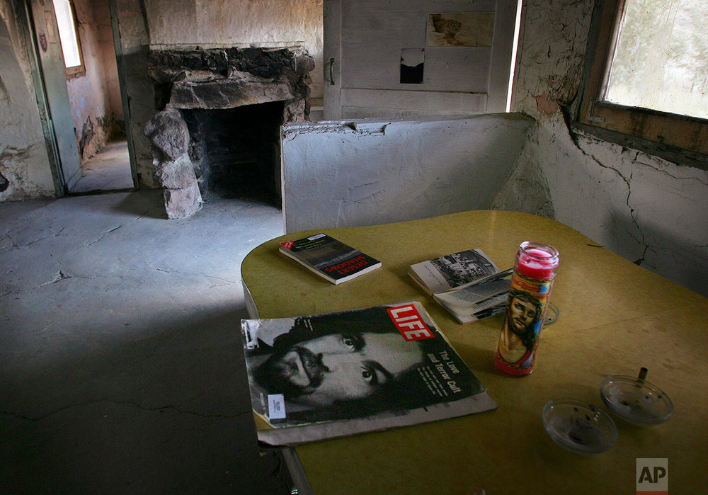 A Life magazine with Charles Manson on the cover is left on a the kitchen table in the abandoned Barker Ranch house by investigators searching the area for clandestine gravesites , Friday, Feb. 22, 2008 in the Panamint Mountains west of Death Valley National Park, Calif. Manson and his followers retreated to the Barker Ranch after a killing spree during the summer of 1969.The high desert wasteland outside of town hides the ranch where a paranoid Charles Manson and his followers holed up after their orgy of murder nearly four decades ago. Now, as then, few venture into this alkaline wilderness _ gold-diggers, outlaws, loners content to live and let live. But a determined group of outsiders recently made the trek. They were in search of more evidence of death. (AP Photo/Gary Kazanjian)
