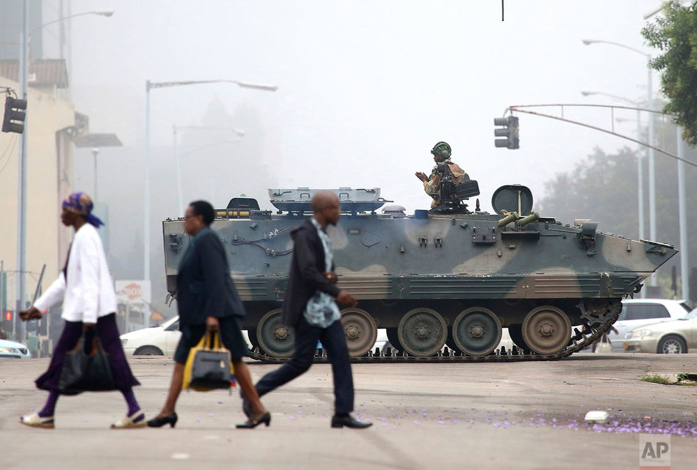 An armed soldier patrols a street in Harare, Zimbabwe, Wednesday, Nov. 15, 2017. Zimbabwe's army said Wednesday it has President Robert Mugabe and his wife in custody and is securing government offices and patrolling the capital's streets following a night of unrest that included a military takeover of the state broadcaster. (AP Photo)