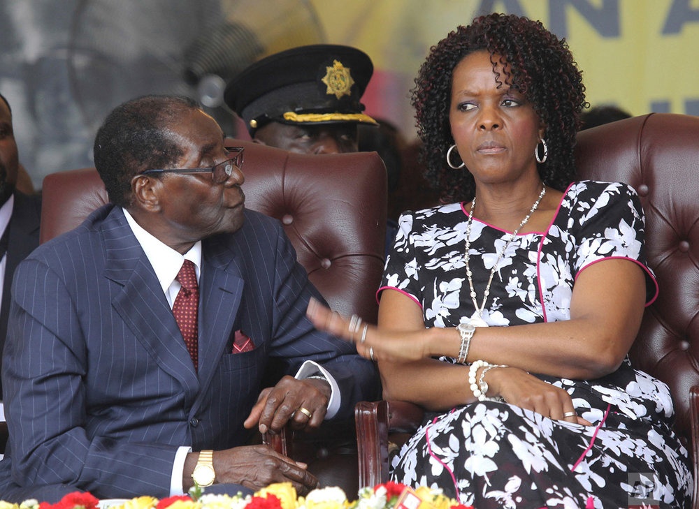 In this Feb. 27, 2016 photo, Zimbabwe President Robert Mugabe and his wife Grace attend his birthday celebrations in Masvingo. (AP Photo/Tsvangirayi Mukwazhi)