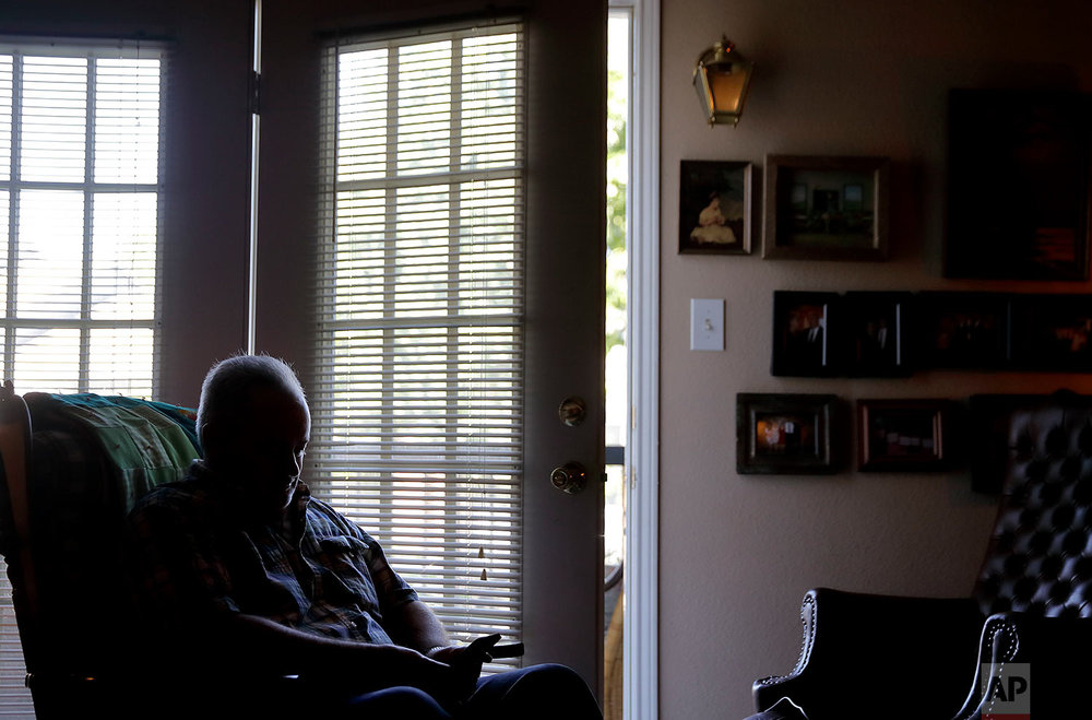 Kyle Graves sits in the home he shares with his mother. (AP Photo/David Goldman)
