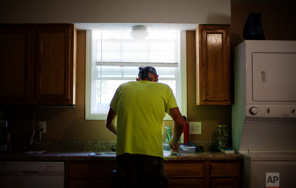 eff McCoy prepares dinner for this wife before she comes home from work in Dickson, Tenn., Wednesday, June 7, 2017. When popping Vicodin pills stopped working, he was prescribed fentanyl patches, powerful opioid medicine often used for intractable cancer pain. Placed on the skin, they deliver medicine gradually. McCoy figured out that yanking them off and chewing them worked faster. He didn't know it can be fatal. (AP Photo/David Goldman)