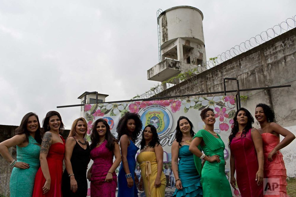 Female inmates pose in evening gowns during their jail's annual beauty contest at the Talavera Bruce penitentiary in Rio de Janeiro, Brazil, early Thursday, Nov. 23, 2017. (AP Photo/Silvia Izquierdo)