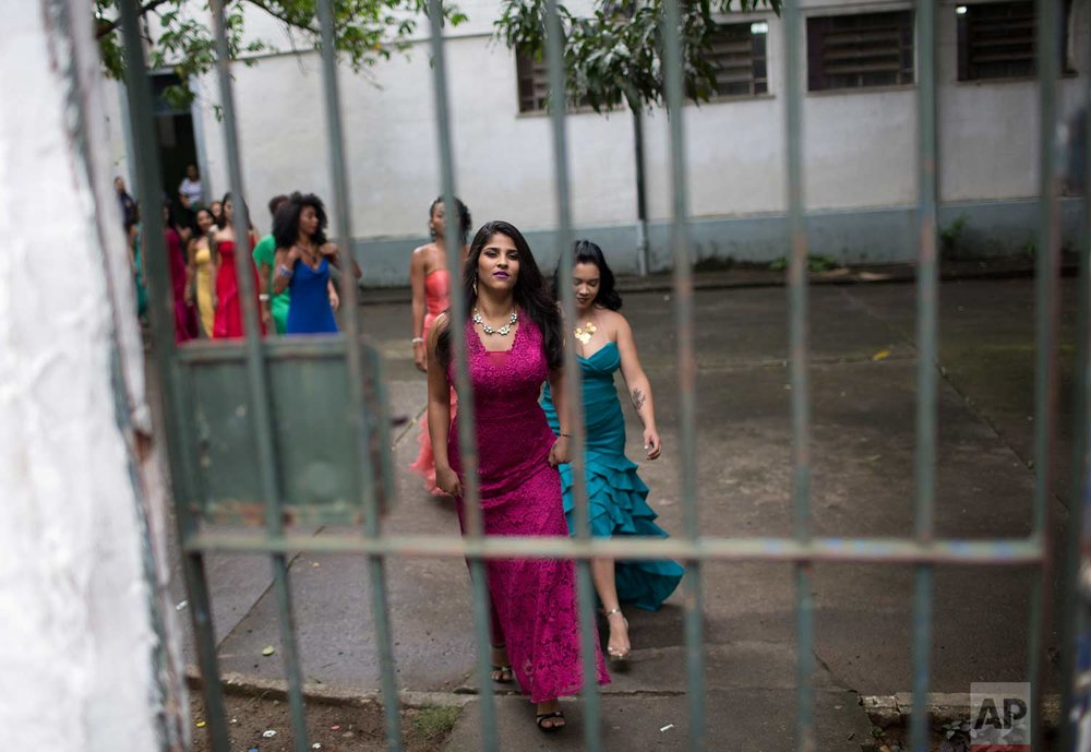 Female inmates wear evening gowns on the morning of their annual beauty contest at Talavera Bruce penitentiary in Rio de Janeiro, Brazil, early Thursday, Nov. 23, 2017. (AP Photo/Silvia Izquierdo)