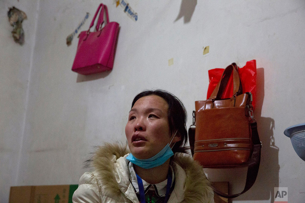 Zhou Xinci, a migrant from Heilongjiang, talks about her fears of being evicted in her rented apartment in the outskirts of Beijing, China, Monday, Nov. 27, 2017. (AP Photo/Ng Han Guan)