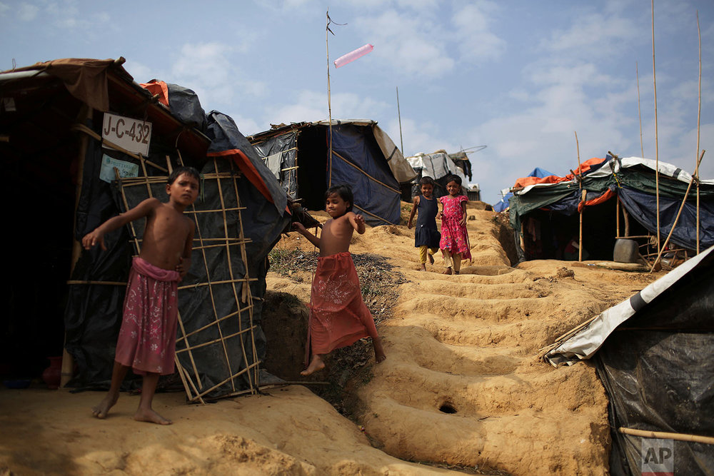 """Rohingya children walk to and from tents in Jamtoli refugee camp on Friday, Nov. 24, 2017, in Bangladesh. Since late August, more than 620,000 Rohingya have fled Myanmar's Rakhine state into neighboring Bangladesh, seeking safety from what the military described as """"clearance operations."""" The United Nations and others have said the military's actions appeared to be a campaign of """"ethnic cleansing,"""" using acts of violence and intimidation and burning down homes to force the Rohingya to leave their communities. (AP Photo/Wong Maye-E)"""