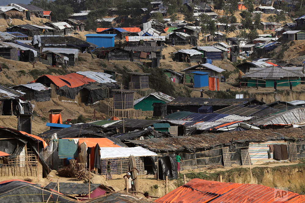 "In this Sunday, Nov. 19, 2017, photo, tents are seen in the Kutupalong refugee camp in Bangladesh where Rohingya Muslims live, after crossing over from Myanmar into Bangladesh. More than 620,000 Rohingya have fled Rakhine for neighbouring Bangladesh since late August 2017, when the military launched what it called ""clearance operations"" in response to insurgent attacks. (AP Photo/Wong Maye-E)"