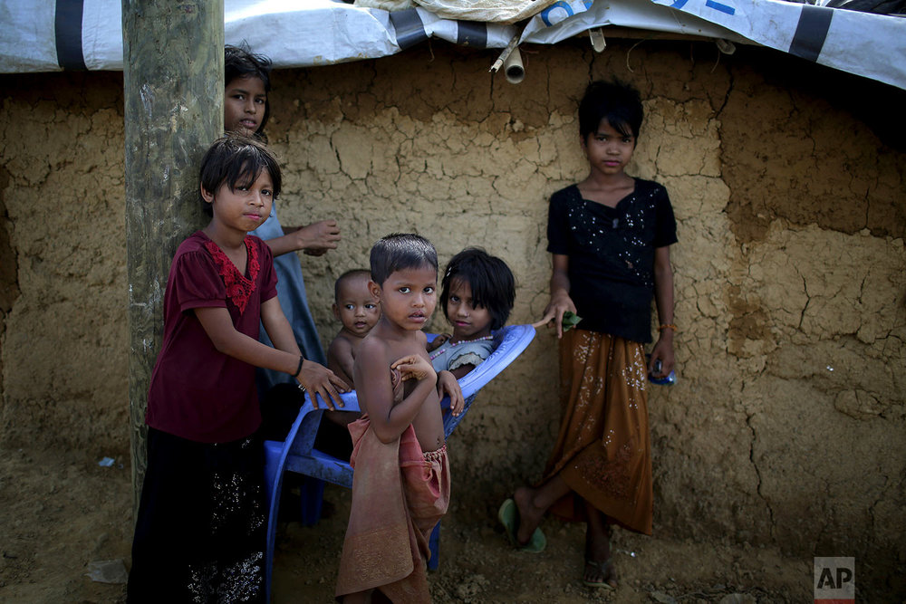 """In this Sunday, Nov. 19, 2017, photo, Rohingya Muslim children sit together in Kutupalong refugee camp in Bangladesh. More than 620,000 Rohingya have fled Rakhine for neighbouring Bangladesh since late August 2017, when the military launched what it called """"clearance operations"""" in response to insurgent attacks. (AP Photo/Wong Maye-E)"""