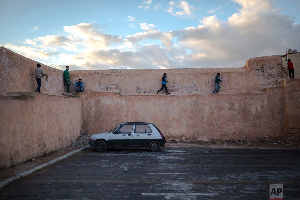 In this Thursday Nov. 30, 2017 photo, children run through ramparts of the old Medina of Sale to take part in an annual parade celebrating the birth anniversary of Prophet Muhammad, near Rabat, Morocco. A large parade with historic roots takes place in the Moroccan city of Sale each year to mark the birth of Prophet Muhammad, an occasion Muslims around the world observe as Mawlid an-Nabi. (AP Photo/Mosa'ab Elshamy)