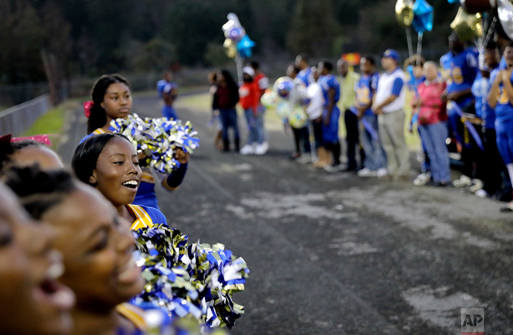 South Robeson High School cheerleader Amare Leach cheers before a football game in Rowland, N.C., Friday, Oct. 27, 2017. (AP Photo/David Goldman)