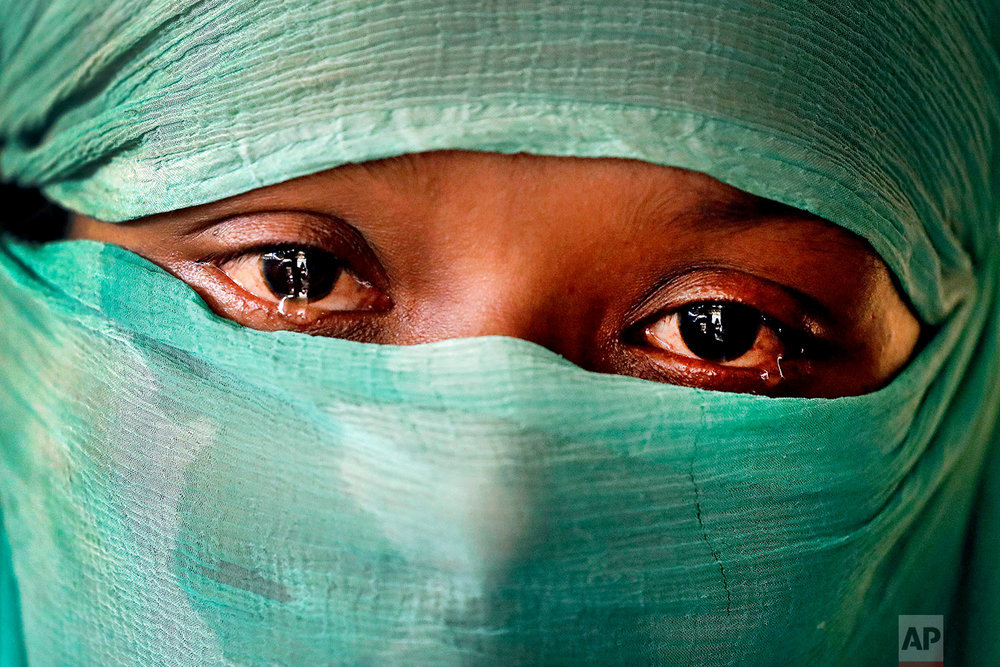 In this Wednesday, Nov. 22, 2017, photo, F, 22, who says she was raped by members of Myanmar's armed forces in June and again in September, is photographed in her tent in Kutupalong refugee camp in Bangladesh.  (AP Photo/Wong Maye-E)