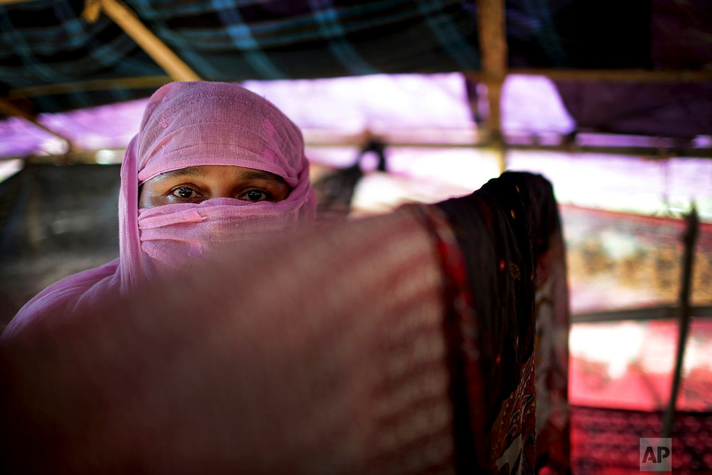 In this Monday, Nov. 20, 2017, photo, M, 30, mother of four, who says she was raped by members of Myanmar's armed forces in late August, is photographed in her tent in Kutupalong refugee camp in Bangladesh.  (AP Photo/Wong Maye-E)