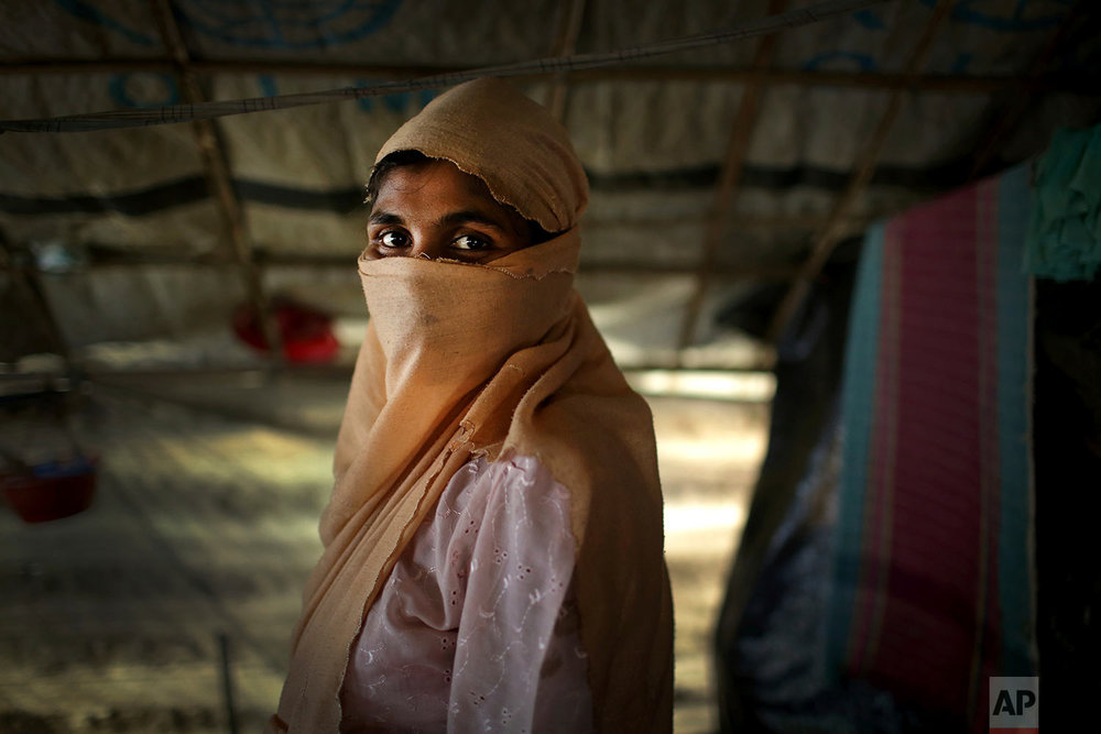 In this Monday, Nov. 20, 2017, photo, S, 25, mother of two, who says she was raped by members of Myanmar's armed forces in late August, is photographed in her friend's tent in Kutupalong refugee camp in Bangladesh.  (AP Photo/Wong Maye-E)