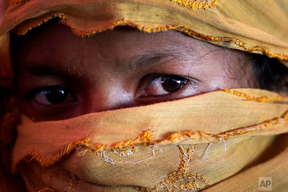 In this Thursday, Nov. 23, 2017, photo, S, 22, mother of one, who says she was raped by members of Myanmar's armed forces in late August, is photographed in her tent in Gundum refugee camp in Bangladesh.  (AP Photo/Wong Maye-E)