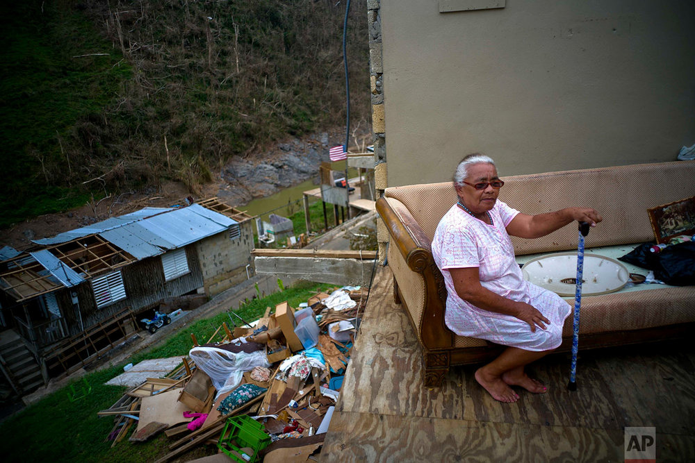 "Juana Sortre Vazquez sits on her soaked couch in what remains of her home, destroyed by Hurricane Maria in the San Lorenza neighborhood of Morovis, Puerto Rico, Saturday, Sept. 30, 2017. ""The night of the hurricane I spent the night at a niece's house. I did not come back for the next nine days because the roads where out. When I made it home I saw that is was all gone. This is a disaster,"" reflected Vazquez. (AP Photo/Ramon Espinosa)"