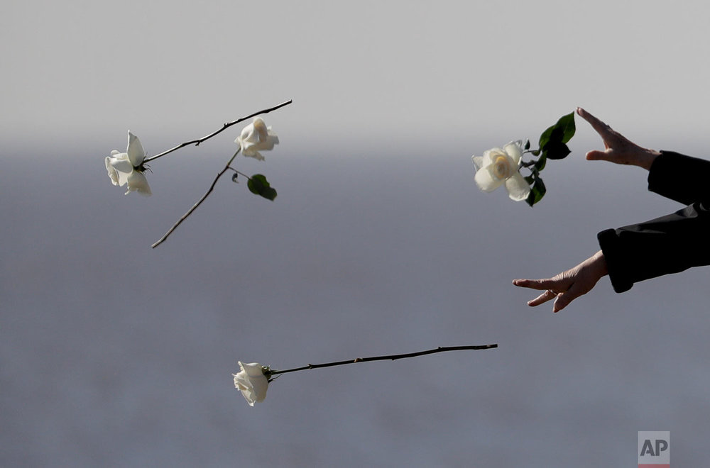 "Chile's President Michelle Bachelet throws a flower into the river during a visit to Memory Park which honors the victims of the country's dictatorship in Buenos Aires, Argentina, Thursday, July 20, 2017. Argentina's so-called ""dirty war"" during the 1976-1983 military dictatorship still haunts Argentines four decades after the end of state-sponsored violence against leftists. (AP Photo/Natacha Pisarenko)"