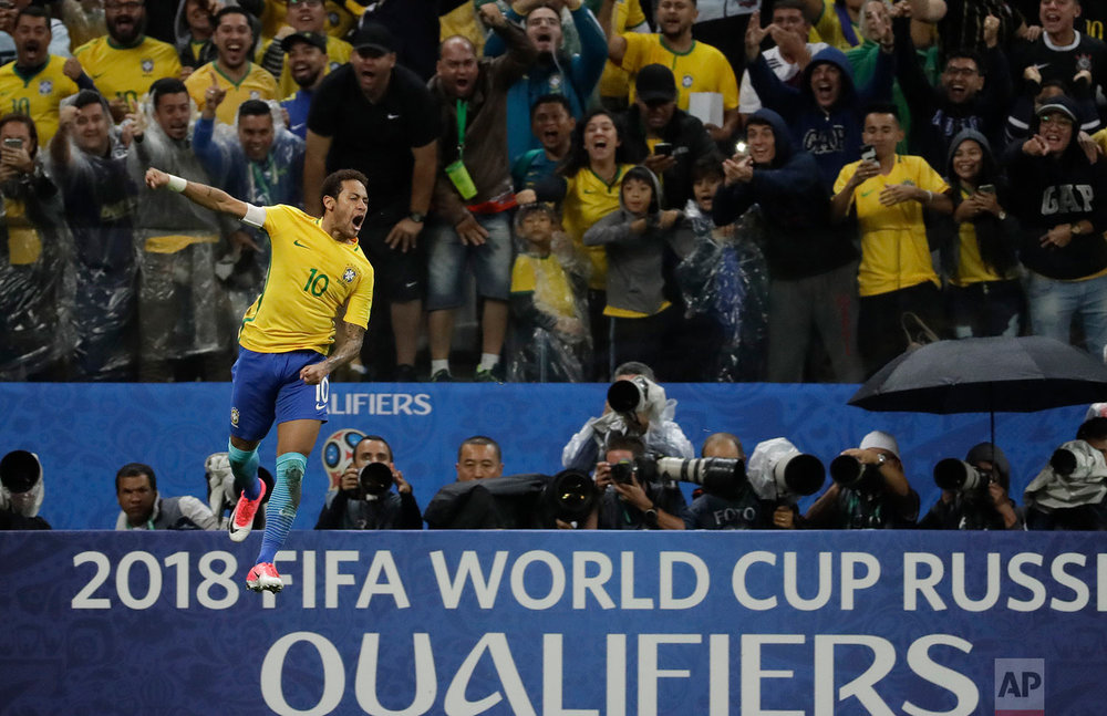 Brazil's Neymar celebrates scoring against Paraguay at a 2018 World Cup qualifying soccer match in Sao Paulo, Brazil, Tuesday, March 28, 2017. (AP Photo/Andre Penner)