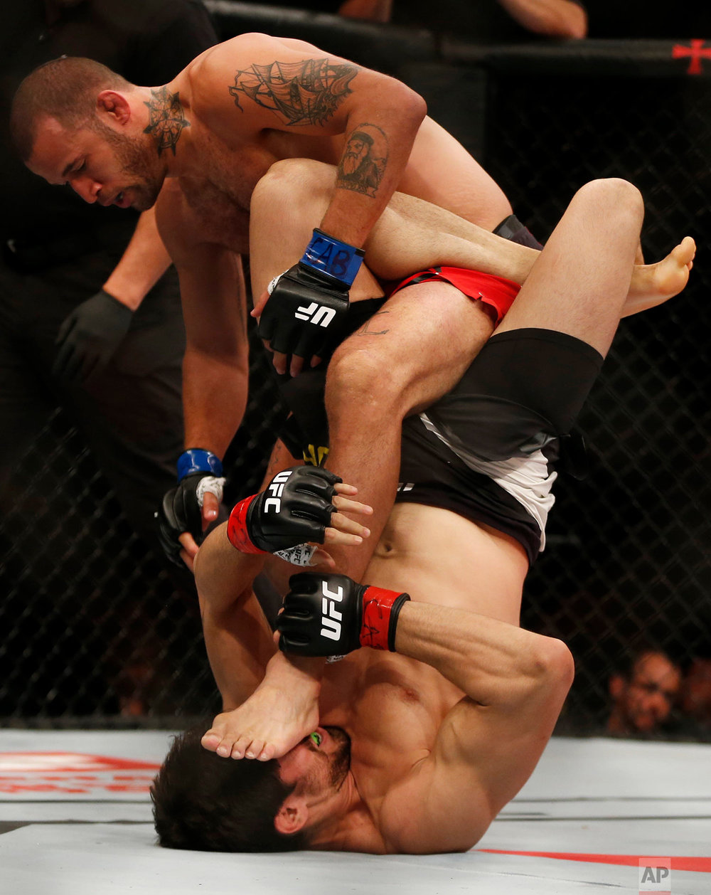 U.S.' Eric Spicely, top, fights Brazil's Antonio Carlos Junior during their UFC middleweight mixed martial arts bout in Rio de Janeiro, Brazil, Saturday, June 3, 2017. (AP Photo/Leo Correa)